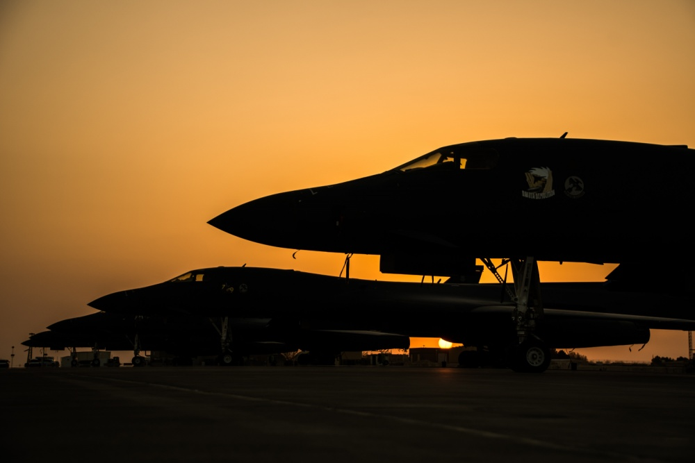 B-1B Lancers sit on the flightline during sunset at Al Udeid Air Base, Qatar, June 27, 2018. The BONE is currently deployed to the U.S. Air Forces Central Command's AOR supporting a wide range of operations. (U.S. Air Force photo by Tech. Sgt. Ted Nichols)