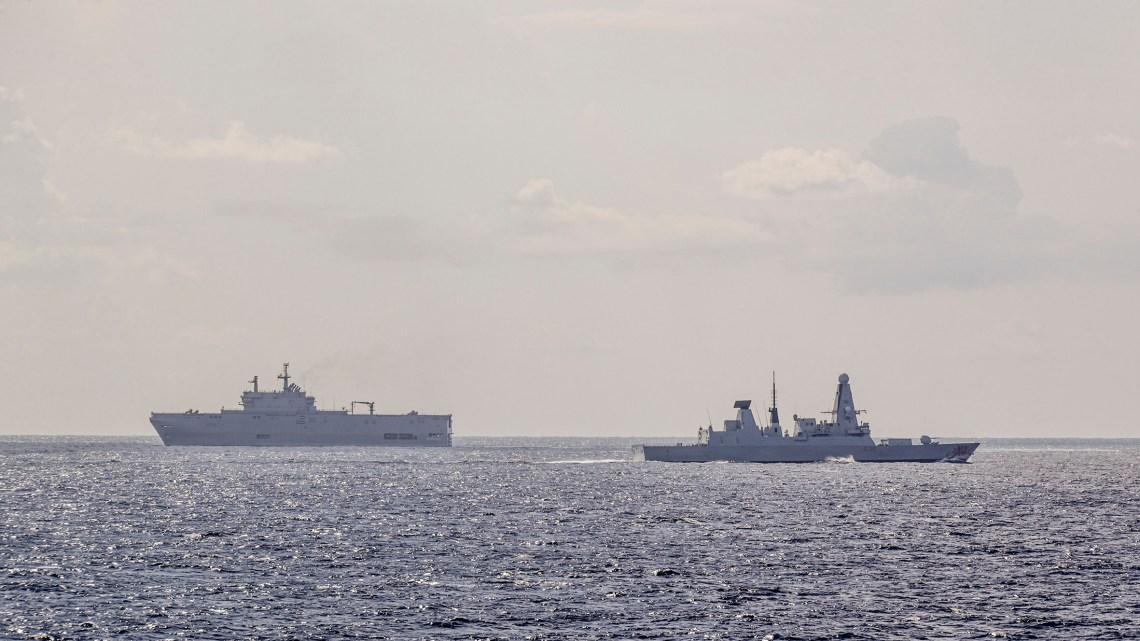 Royal Navy HMS Dragon sails near Egyptian assault ship ENS Sadat