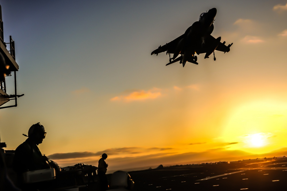 An AV-8B Harrier II assigned to the air combat element of the 13th Marine Expeditionary Unit takes off from the amphibious assault ship USS Boxer (LHD 4).