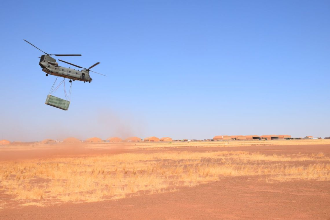 An RAF Chinook and 3 Joint Helicopter An RAF Chinook and 3 Joint Helicopter Support Squadron Personnel lifts a heavy ISO container in order to assist with French Op BARKHANE, Camp Roberts, Gao, Mali.