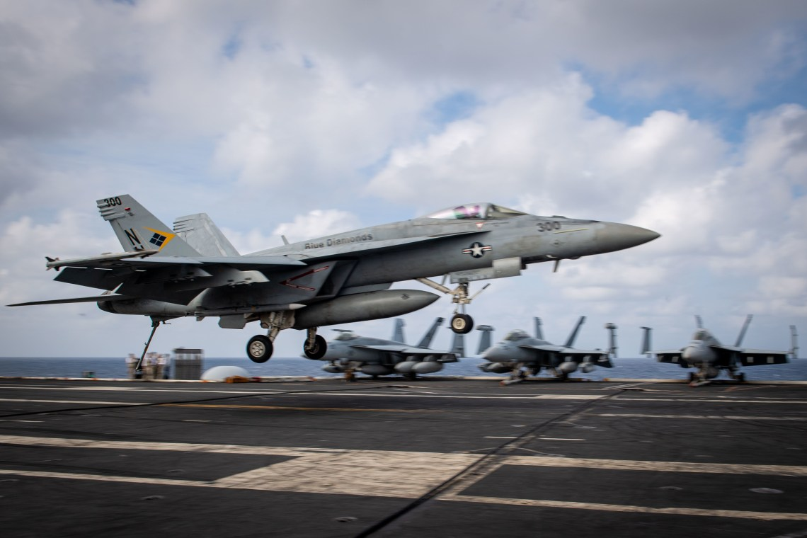 "An F/A-18E Super Hornet, assigned to the ""Blue Diamonds"" of Strike Fighter Squadron (VFA) 146, lands on the flight deck of the aircraft carrier USS Theodore Roosevelt (CVN 71)."
