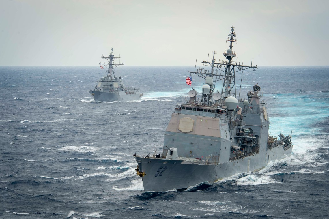 The Ticonderoga-class guided-missile cruiser USS Bunker Hill (CG 52), front, and the Arleigh Burke-class guided-missile destroyer USS John Finn (DDG 113) transit the Pacific Ocean.