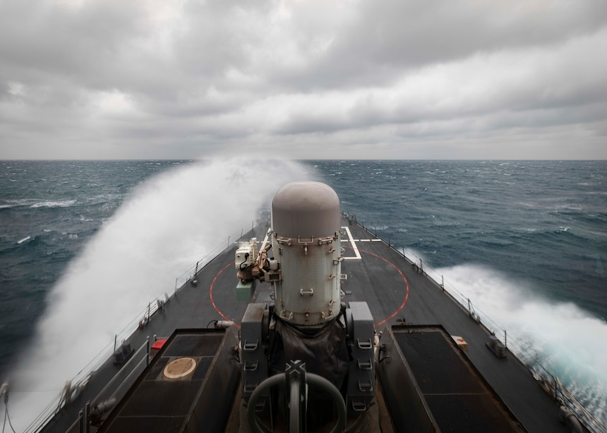 Cmdr. Ryan T. Easterday, commanding officer of the guided-missile destroyer USS John S. McCain (DDG 56) scans the horizon from the bridge wing as the ship conducts routine underway operations in support of stability and security for a free and open Indo-Pacific.