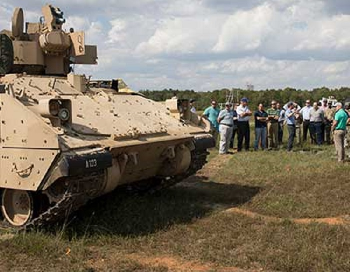 A U.S. Army-led MAPS team takes to the field at Redstone Test Center in 2019 to demonstrate a layered defense capability to defeat threats. This was the first use of the base kit in a ground vehicle, in this case a Bradley.