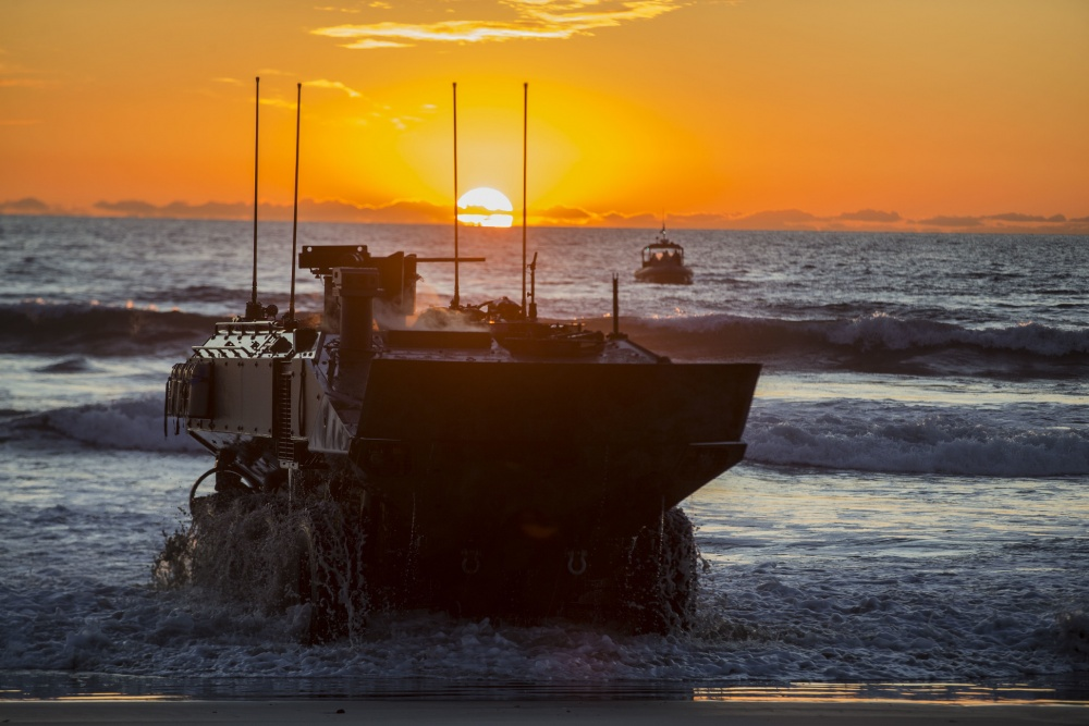 U.S. Marines with Amphibious Vehicle Test Branch, Marine Corps Tactical Systems Support Activity, drive a new Amphibious Combat Vehicle ashore during low-light surf transit testing at AVTB Beach on Marine Corps Base Camp Pendleton, California, Dec. 18, 2019.