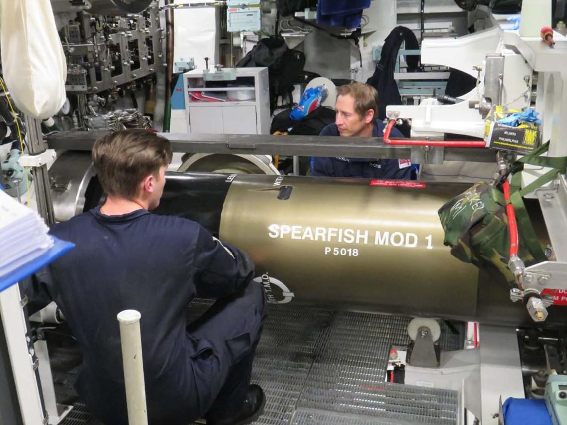 Crew preparing 'Mod-1' Spearfish torpedo for trial on-board HMS Audacious