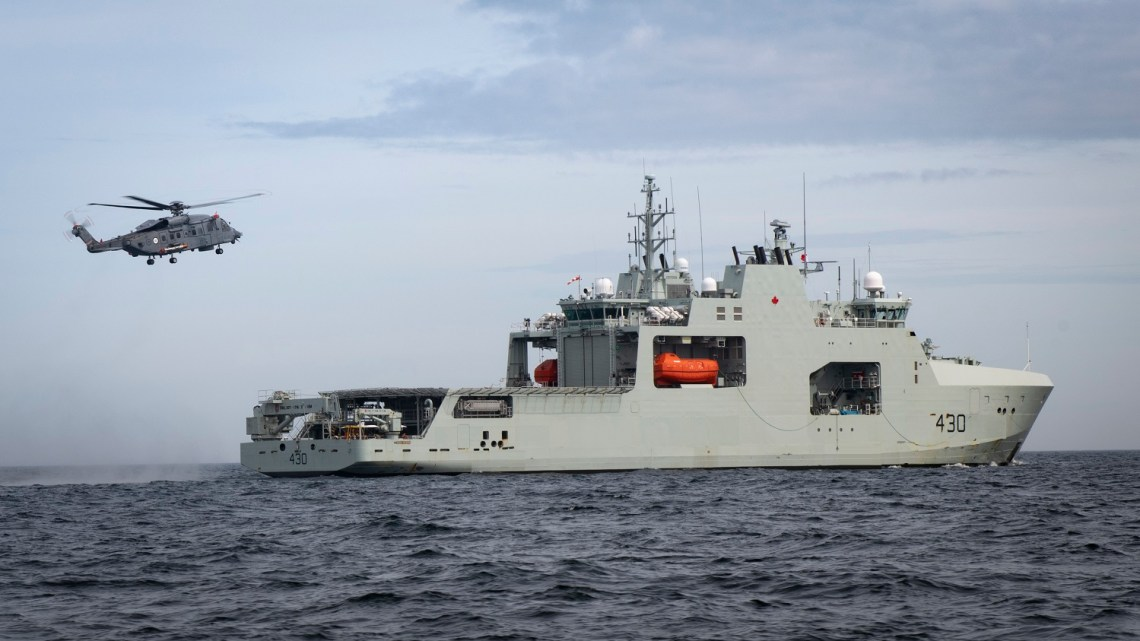 CH148819 Cyclone from 12 Wing Shearwater flies off the stern of HMCS HARRY DEWOLF during Phase 4 Shipboard Helicopter Operating Limits off the coast of Nova Scotia on June 3, 2021.