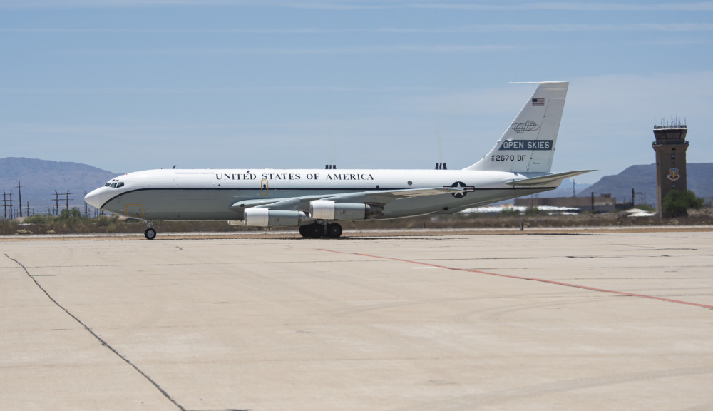 An OC-135B Open Skies assigned to the 55th Wing, Offutt Air Force Base, Nebraska, is guided to its designated parking spot on the flightline at Davis-Monthan Air Force Base, Ariz. June 9, 2021.