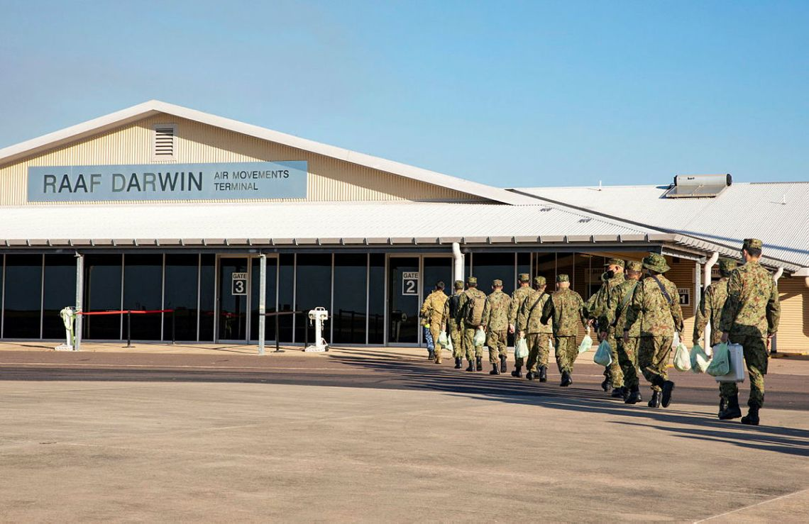 Members of the Japan Self-Defense Forces arrive in the Top End, after completing quarantine in Sydney, aboard a Royal Australian Air Force C130J Hercules aircraft prior to participation in the upcoming trilateral exercise Southern Jackaroo 2021.