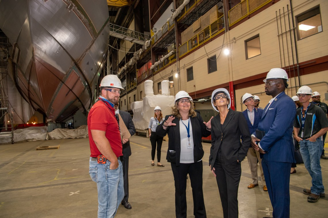Jan Allman, CEO of Fincantieri Marinette Marine (FMM) and Robyn Modly, Ship Sponsor for Littoral Combat Ship (LCS) 31, the future USS Cleveland, tour Fincantieri Marinette Marine's shipyard.