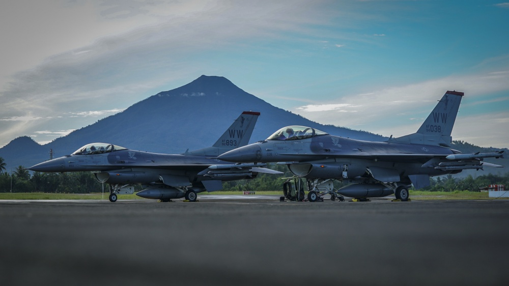 U.S. Air Force F-16C Fighting Falcons assigned to the 13th Expeditionary Fighter Squadron, 35th Fighter Wing based out of Misawa Air Base, Japan prepare to takeoff for the final sortie of exercise Cope West 18 (CW18) at Sam Ratulangi International Airport, Indonesia, March 23, 2018.