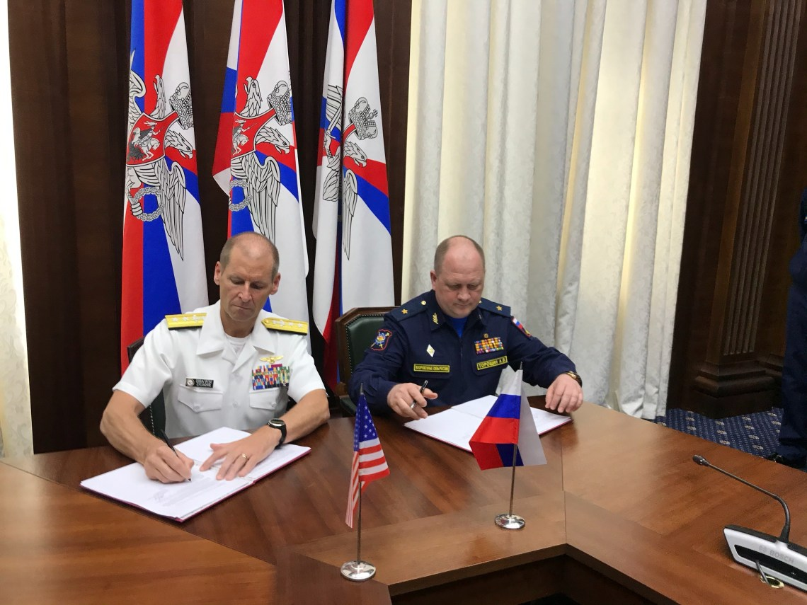 Rear Adm. Shawn Duane, left, head of the U.S. delegation, shakes hands with his Russian counterpart after signing the Prevention of Incidents On and Over the Waters Outside the Limits of the Territorial Sea (INCSEA) agreement in Moscow, May 25, 2021.