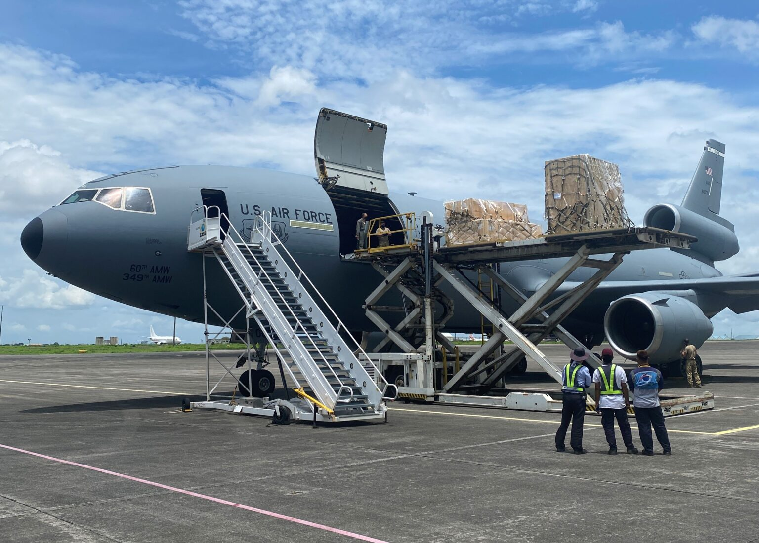 U.S. Air Force personnel unload weapons and equipment off a KC-10 Extender at Clark Air Base.