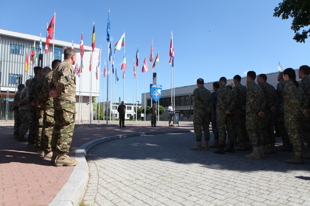 NATO participants stand in formation during the opening day ceremony of CWIX 2021 on June 9th, 2021 at Joint Force Training Centre at Bydgoszcz, Poland.