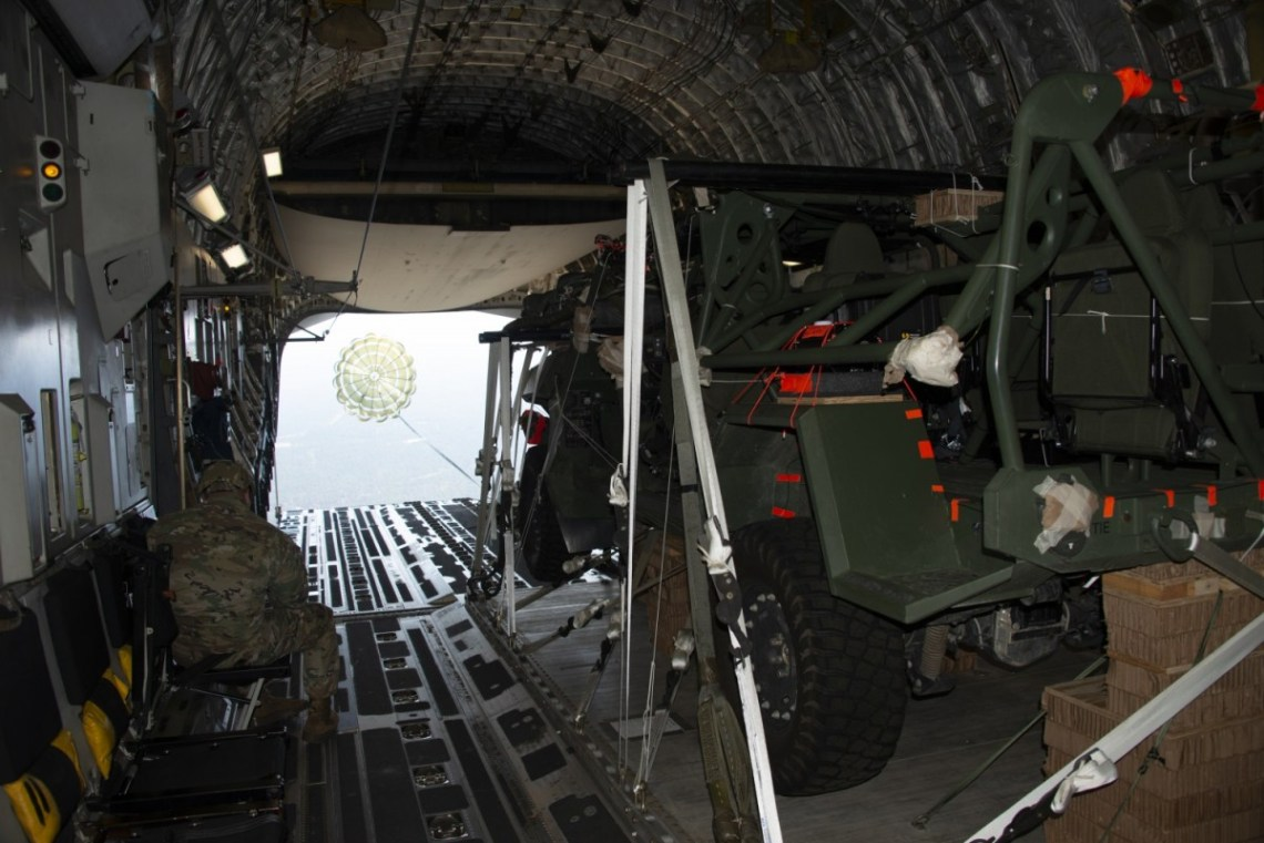 An Infantry Squad Vehicle (ISV) is extracted out of a U.S. Air Force C-17 aircraft by a 22-foot extraction parachute during a low-velocity airdrop (LVAD) during operational testing at Fort Bragg, North Carolina.