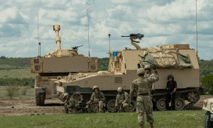 US Army M109A7 self-propelled howitzer and M992A3 field artillery ammunition support vehicle.