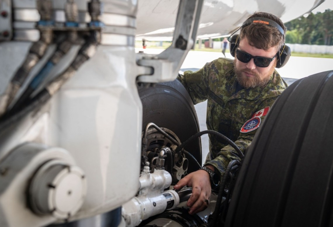 E3-A component engineer service the aircraft between sorties during Ex Ramstein Alloy. Photo courtesy of SHAPE PAO.