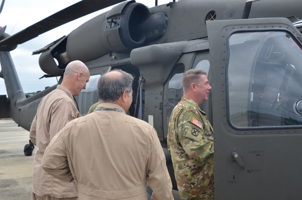 Maj. Gen. Todd Hunt, right, the North Carolina Adjutant General and chairman of the Army National Guard Aviation Readiness Council, enters the cockpit of a UH-60V Black Hawk helicopter at the Huntsville, Al. International Airport July 13 for a demonstration flight of the aircraft.