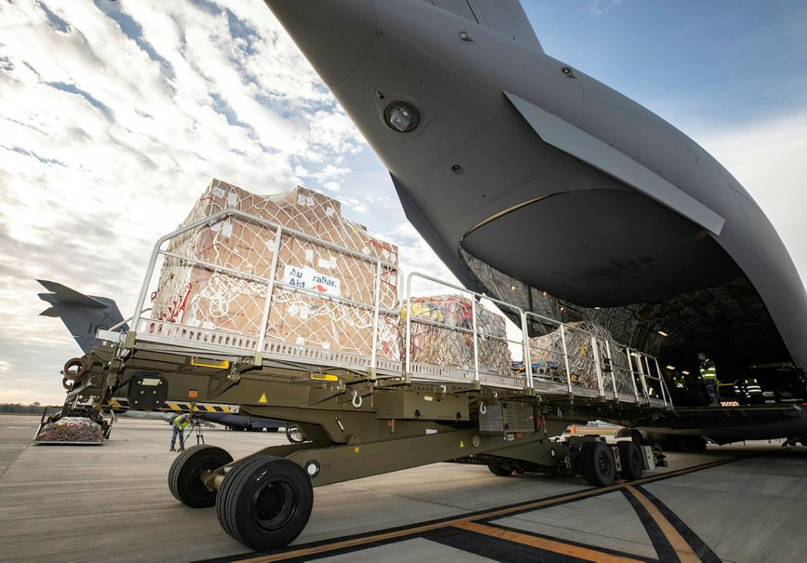 Humanitarian aid equipment is loaded into a No. 36 Squadron C-17A Globemaster III aircraft in order to be delivered to Fiji in response to a COVID-19 outbreak across the nation.