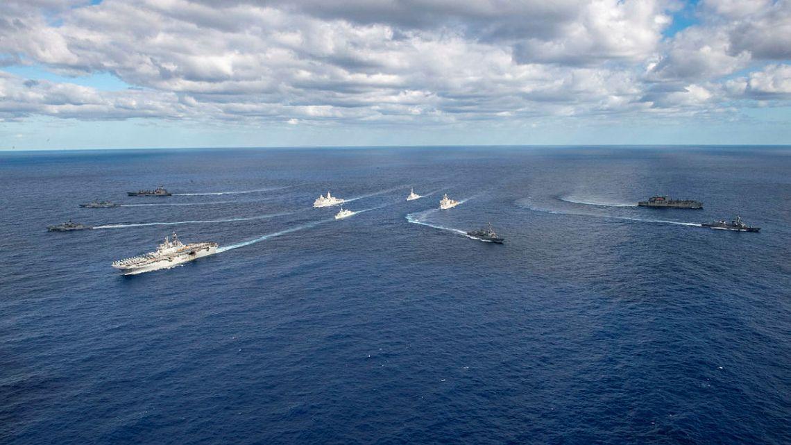 (From left) USNS Rappahannock (T-AO 204), ROKS Wang Geon (DD 978), HMAS Parramatta (FFH 154), USS America (LHA 6), USS Rafael Peralta (DDG 115), JS Makinami (DD 112), USNS Alan Shepard (T-AKE 3), (center) HMCS Calgary (FFH 335), (back) USS New Orleans (LPD 18), HMAS Brisbane (DDG 41), and USS Germantown (LSD 42) steam in formation during Talisman Sabre 2021.