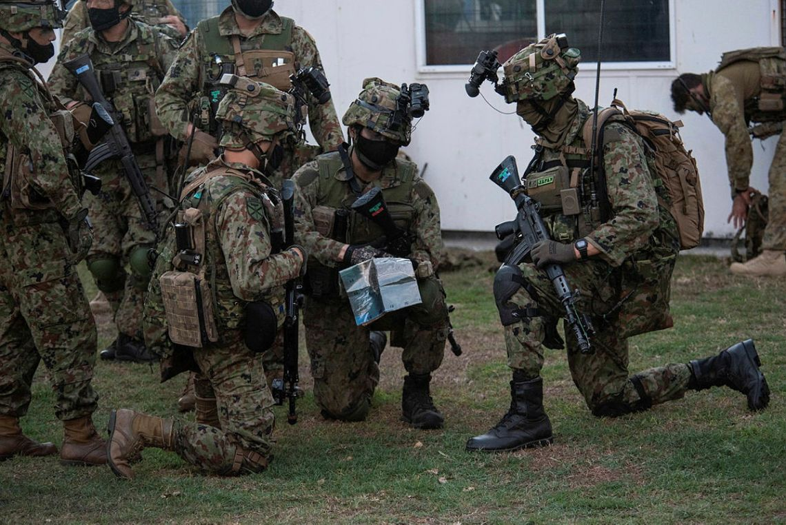 Japanese Ground Self Defense Force soldiers with 2nd Amphibious Rapid Deployment Regiment discuss their approach toward their objective during a training scenario at Exercise Talisman Sabre 21 in Bowen, Queensland.