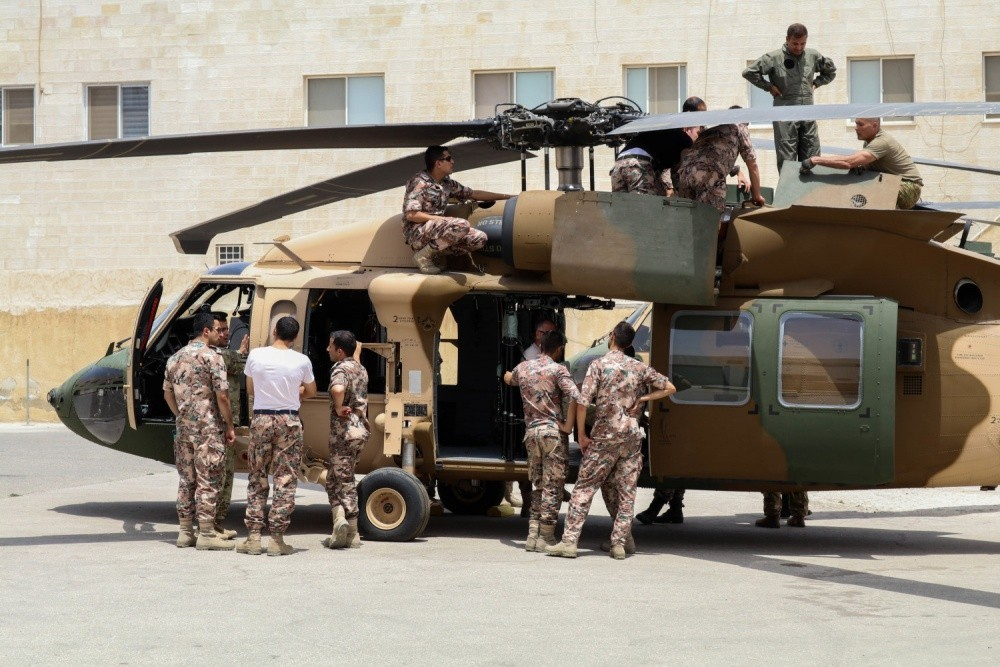 Soldiers of Bravo Company, 449th Aviation Support Battalion, Texas Army National Guard, and members of the Royal Jordanian air force inspect components of a UH-60M Black Hawk helicopter during joint training at a base outside of Amman, Jordan in July 2017. Jordan's most recent aircraft foreign military sales purchase – a Black Hawk that will be upgraded to transport the royal family – will complement Jordan existing Royal Squadron fleet of Black Hawks. (Army photo by Capt. Margaret Ziffer)