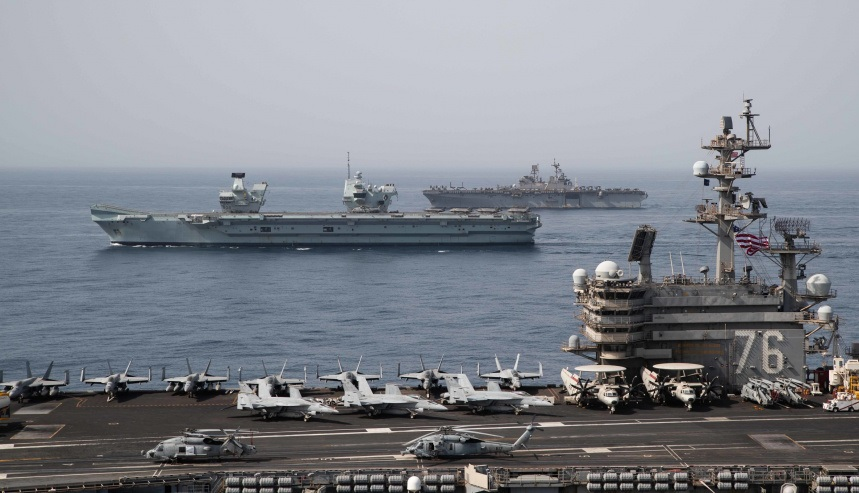Ships of the UK Carrier Strike Group, USS Ronald Reagan Carrier Strike Group, and Iwo Jima Amphibious Ready Group operate in formation in the Gulf of Aden, July 12.