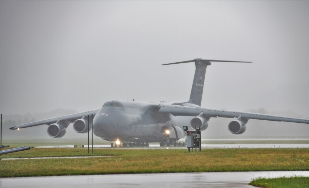 An Air Force C-5M Super Galaxy and aircrew from Dover Air Force Base, Del., carrying Soldiers with the 3rd Brigade Combat Team, 10th Mountain Division of Fort Polk, La., taxies on the runway July 7, 2021, as part of an Emergency Deployment Readiness Exercise (EDRE) at Volk Field, Wis.