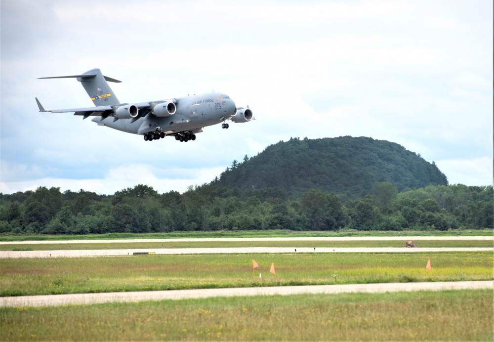 An Air Force C-17 Globemaster III from Joint Base Charleston, S.C., carrying Soldiers with the 3rd Brigade Combat Team, 10th Mountain Division of Fort Polk, La., prepares to land July 7, 2021, as part of an Emergency Deployment Readiness Exercise (EDRE) at Volk Field, Wis.