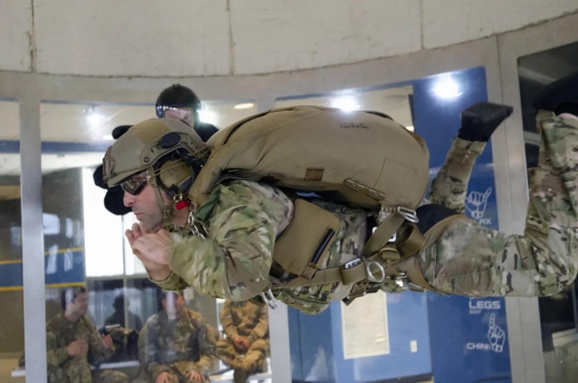 A 3rd Special Forces Group operational Soldier undergoes vertical wind tunnel training prior to live airdrop of the Parachutist Flotation Device (PDF).