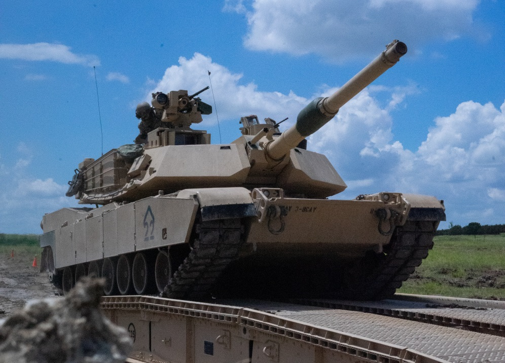 Tankers with 3rd Battalion, 8th Cavalry Regiment, 3rd Armored Brigade Combat Team, 1st Cavalry Division, trek over a Joint Assault Bridge (JAB) in their M1A2 SEPv3 Abrams Main Battle Tank during a combined arms breach exercise, Fort Hood, Texas, June 6, 2021.