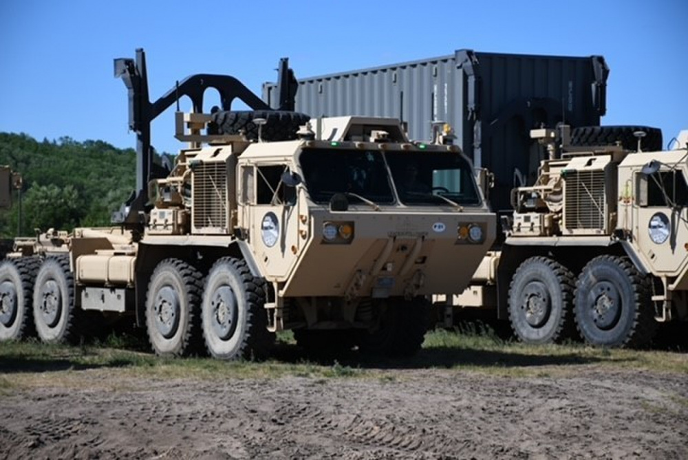 Expedient Leader-Follower trucks at Camp Grayling, Michigan, have been loaded with autonomous technology by U.S. Army engineers and technicians. The trucks are being tested to ensure they can be operated unmanned.