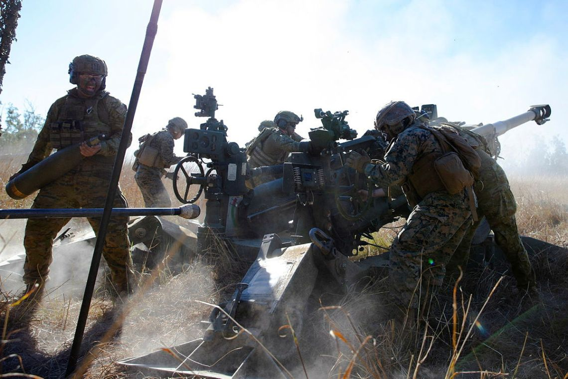 Gunners of the 4th Regiment, Royal Australian Artillery and the United States Marine Corps' Golf Battery, 2nd Battalion, 11th Marines, fire an Australian M777 Howitzer as part of a mixed crew, at Shoalwater Bay Training Area in Queensland during Exercise Talisman Sabre 2021.
