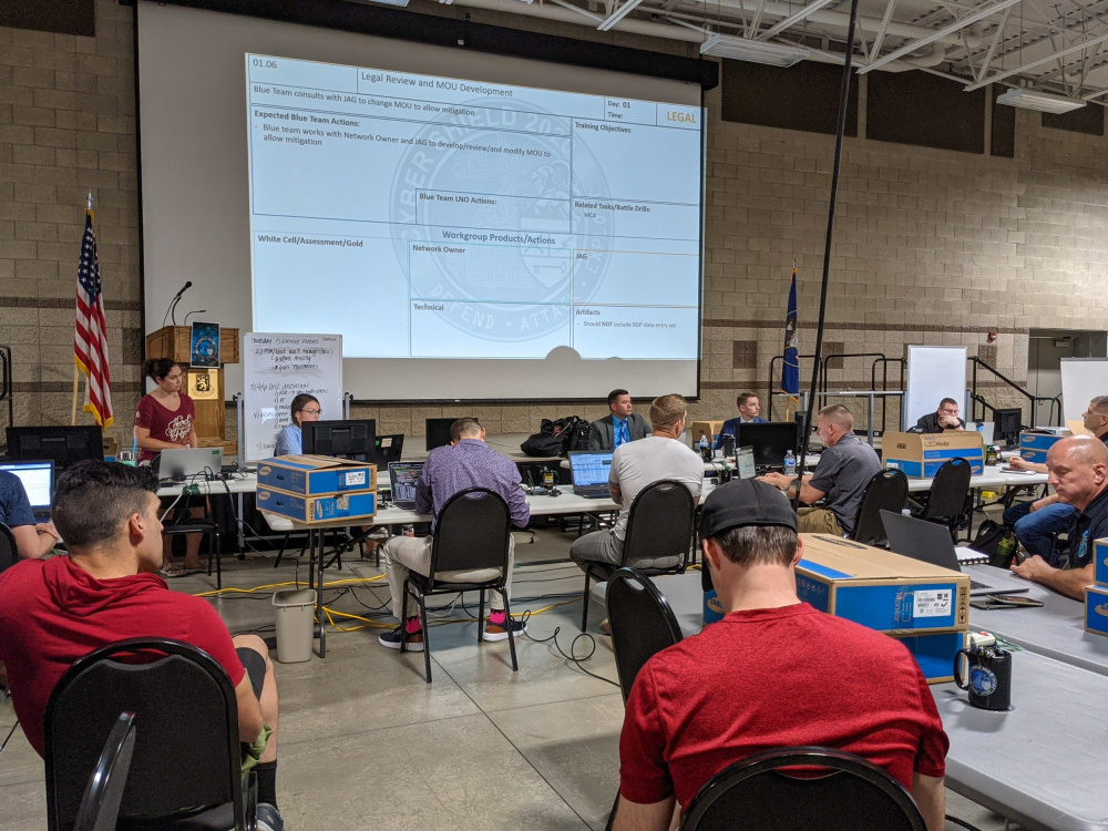 Cyber defense professionals with the ADVON (Advanced Echelon) team for Cyber Shield 21 hold preliminary meeting in the 640th Regiment, Regional Training Institute at Camp Williams, UT, on July 8, 2021.