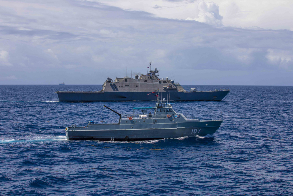 The Freedom-variant littoral combat ship USS Billings (LCS 15) conducts a passing exercise (PASSEX) with Dominican Republic Navy Swiftship-110'-class patrol boat Canopus (GC 107) and Justice Boston whaler-class boat Nunke (LI 163), July 10, 2021.