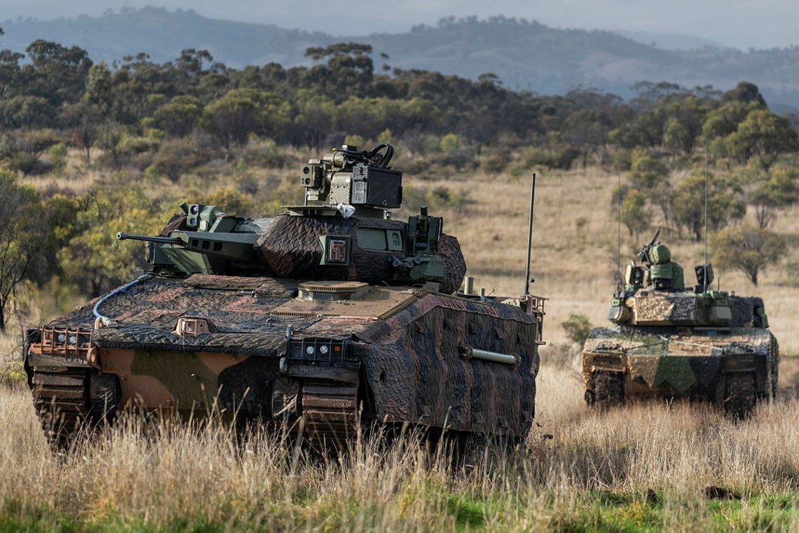 Hanwha Defense Australia Redback Infantry Fighting Vehicle (front) and Rheinmetall Defence Australia LYNX KF41 Infantry Fighting Vehicle (back), conduct LAND 400 Phase 3 user evaluation trials at Puckapunyal Military Area, Victoria.