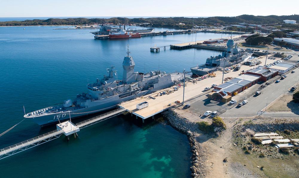 Aerial photograph of HMAS Anzac berthed alongside HMAS Arunta at Fleet Base West in Western Australia.