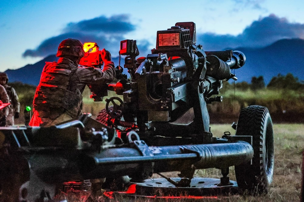 Soldiers from Alpha Battery, 3-7 Field Artillery, 25th Infantry Division Artillery conducted their M119 Howitzer night live fire Table VI certification to set conditions for future artillery operations at Schofield Barracks, Hawaii, May 19, 2021.