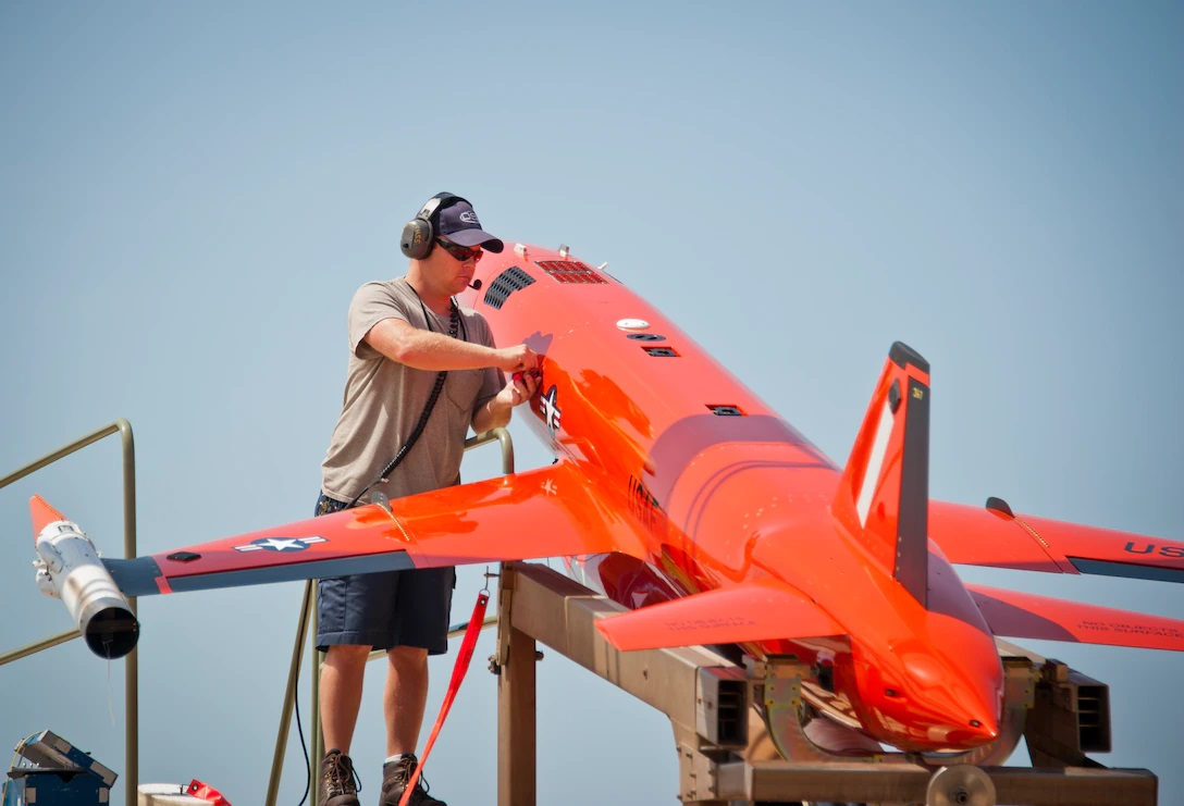 A PAE maintainer from the 82nd Aerial Targets Squadron prepares a BQM-167 at Tyndall Air Force Base, Fla.