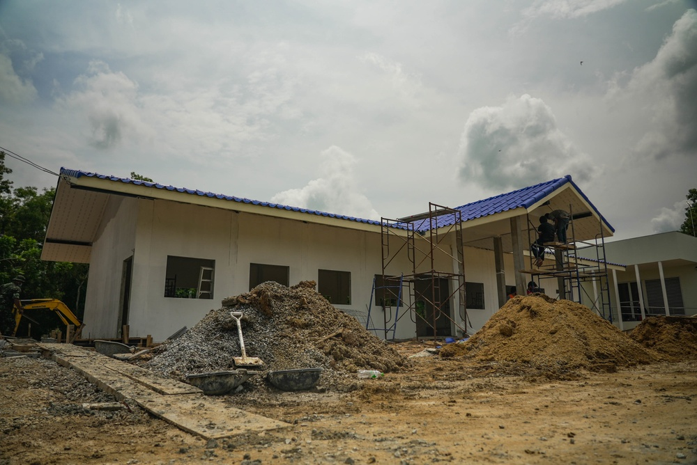 U.S. Marines with Bridge Platoon, Bridge Company, 9th Engineer Support Battalion, 3d Marine Logistics Group and Royal Thai Marines with the Royal Thai Mobile Development Unit 12 construct an 8 X 20-meter multipurpose facility at the Baan Mai Thai Pattaya School, during Exercise Cobra Gold 21.
