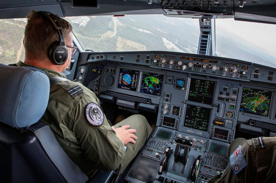 A No. 33 Squadron KC-30A multi-role tanker transport aircraft pilot in the cockpit prior to an air-to-air refuelling sortie in Queensland during Exercise Talisman Sabre 2021.