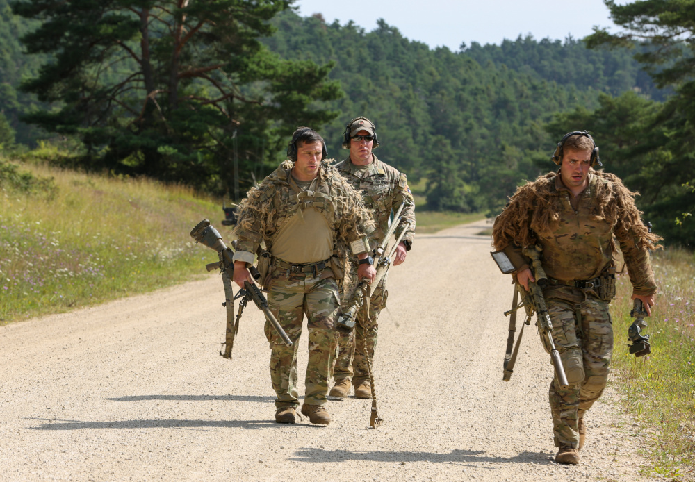 U.S. Soldiers run to the next checkpoint during the 2021 Best Sniper Team Competition at Hohenfels Training Area, Germany