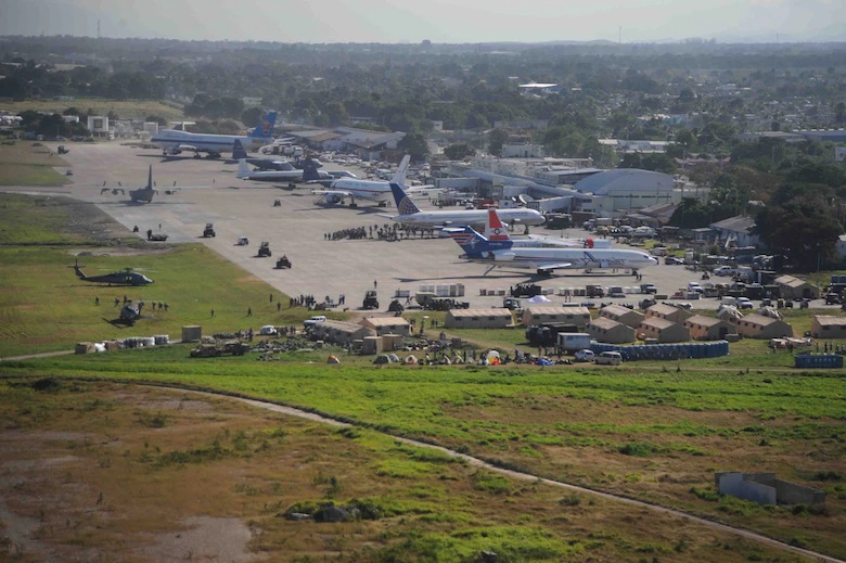 Airplanes wait for off-load to support in earthquake relief efforts at the Port-au-Prince International Airport.