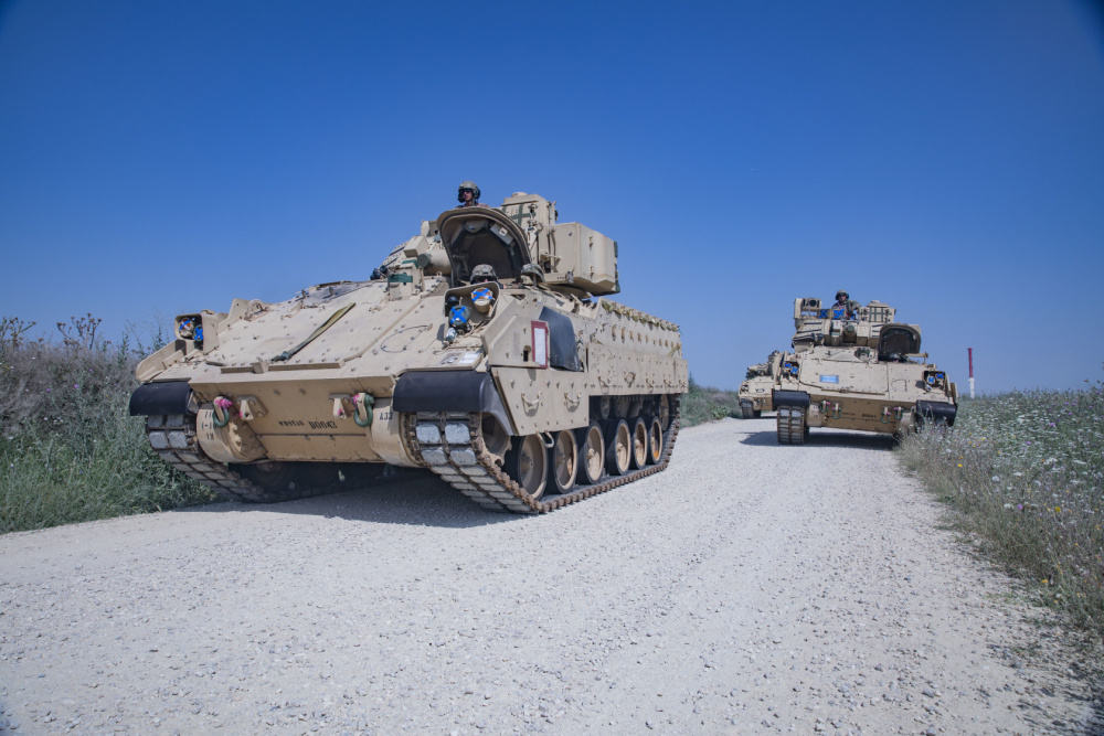 US Army 1st Heavy Brigade Combat Team Off-Load Military Vehicles at Mihail Kogalniceau Air Base, Romania