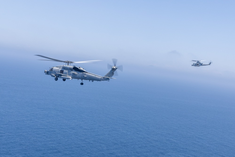 An AH-1Z Viper with Marine Light Attack Helicopter Squadron 267, Marine Aircraft Group 39, 3rd Marine Aircraft Wing (MAW), flies with a U.S. Navy MH-60R Seahawk during the Advanced Naval Basing evolution of Summer Fury 21 at San Clemente, California, July 20, 2021.