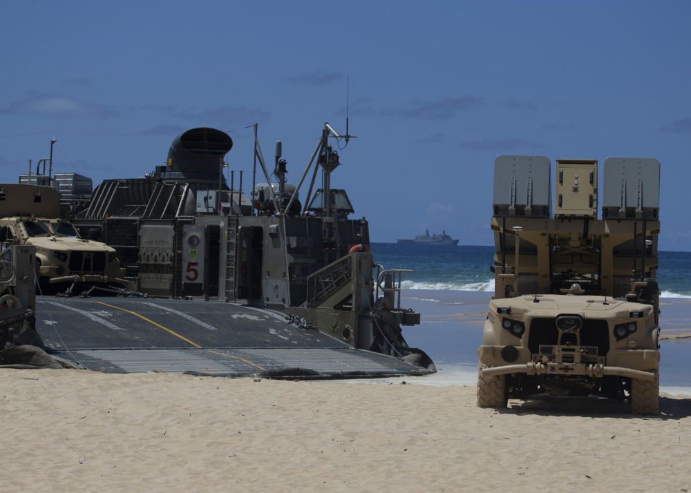 A Navy Marine Expeditionary Ship Interdiction System launcher, a command and control vehicle and a Joint Light Tactical Vehicle are transported by a U.S. Navy Landing Craft Air Cushion from Pacific Missile Range Facility Barking Sands, Hawaii, out to U.S.S. San Diego, Aug. 16, 2021.