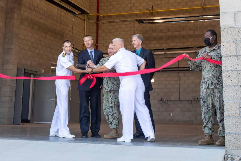 A ribbon cutting ceremony was held at the Assault Craft Unit (ACU) 5 complex onboard Marine Corps Base Camp Pendleton, Calif., to commemorate the completion of the new Expeditionary Warfare Training Group, Pacific (EWTGPAC)