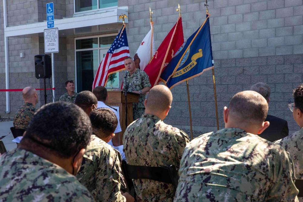 Capt. Dan Cobian, commanding officer of Expeditionary Warfare Training Group, Pacific (EWTGPAC), speaks during a ribbon cutting ceremony at the Assault Craft Unit (ACU) 5 complex onboard Marine Corps Base Camp Pendleton, Calif., to commemorate the completion of the new EWTGPAC Ship to Shore Connector (SSC) training facility.