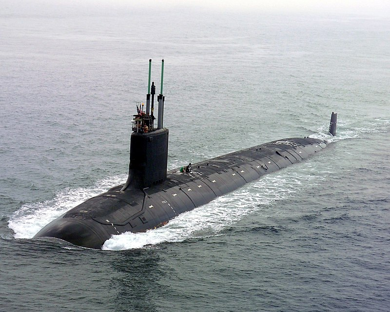 """Groton, Conn. (July 30, 2004) - The nation's newest and most advanced nuclear-powered attack submarine and the lead ship of its class, PCU Virginia (SSN 774) returns to the General Dynamics Electric Boat shipyard following the successful completion of its first voyage in open seas called """"alpha"""" sea trials."""
