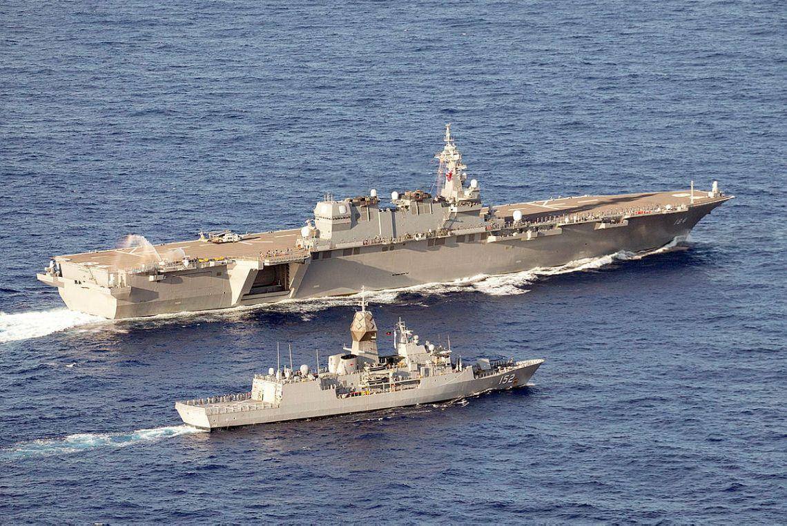 HMAS Warramunga and Japan Maritime Self-Defense Force helicopter carrier JS Kaga sail in-company during Exercise MALABAR 2021.